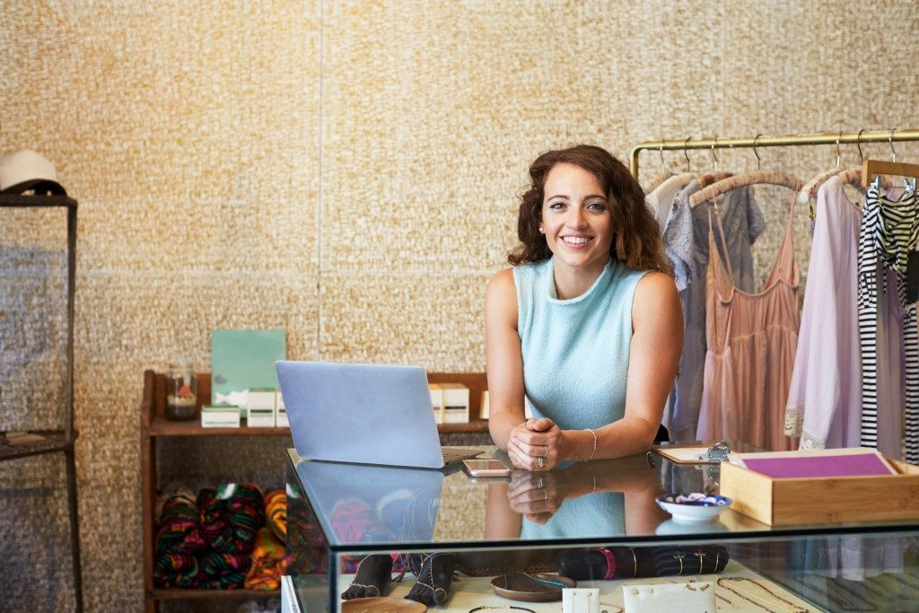 Business owner behind the counter