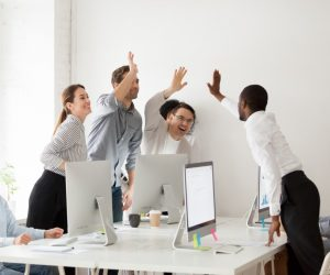 Employees giving each other a high five