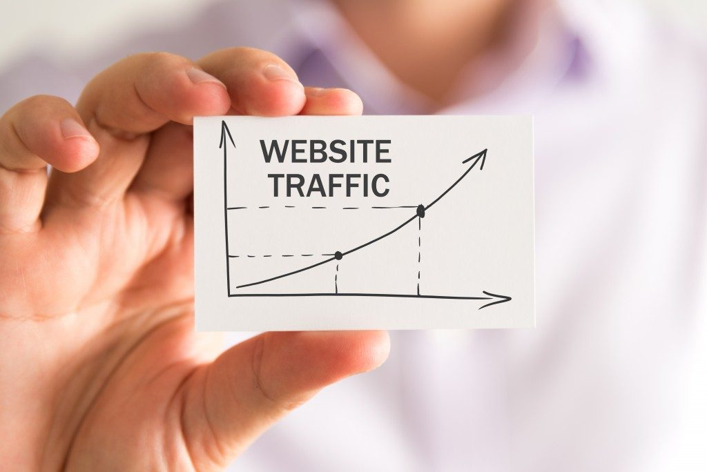 man holding a card that shows a chart of website traffic
