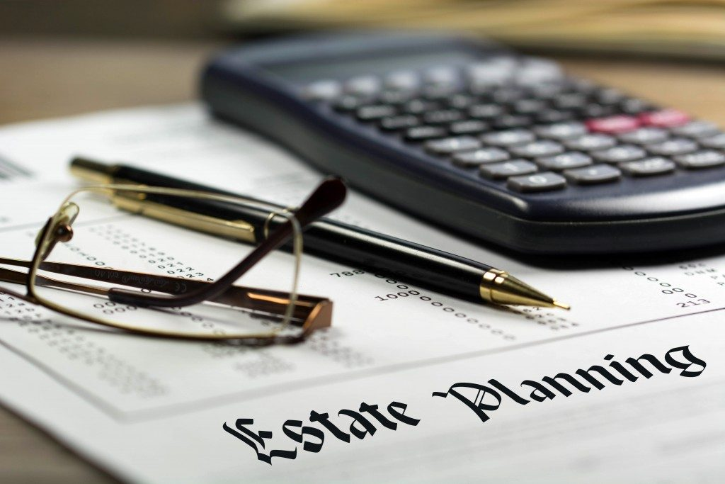 estate planning word written on real estate brokerage concept