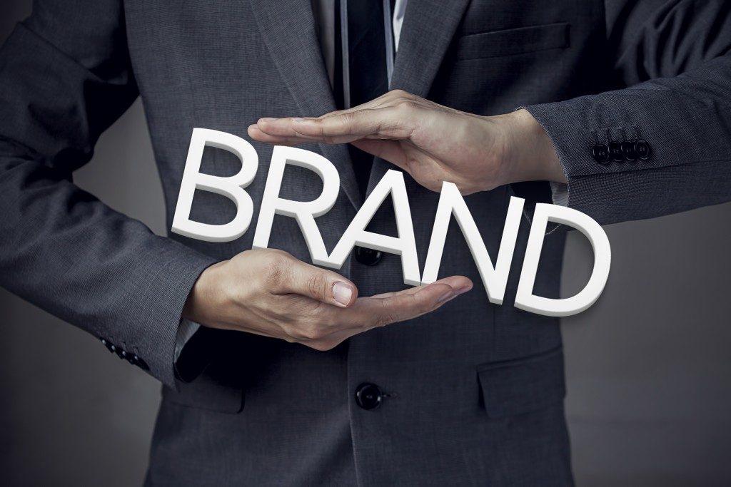 businessman holding brand